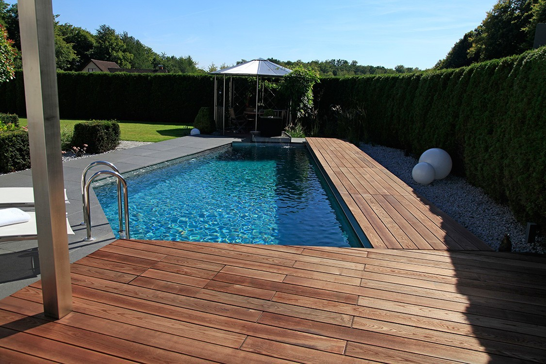 bio pool with stainless steel and natural stone