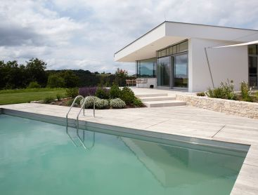 Living Pool in Austria Complements House Architecture