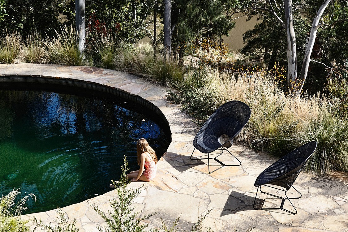 natural pool in Australia with green glass tiles