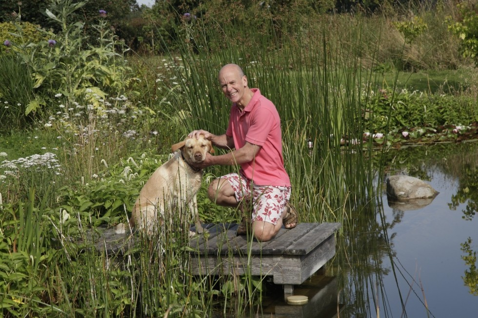 natural pool in UK with dog